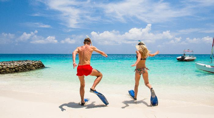 Couple is going to swim and snorkel